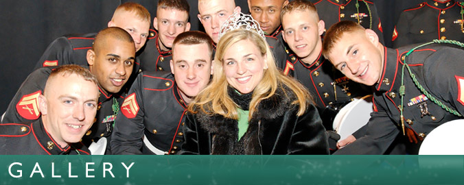 Kristen McCosh poses with a group of service men